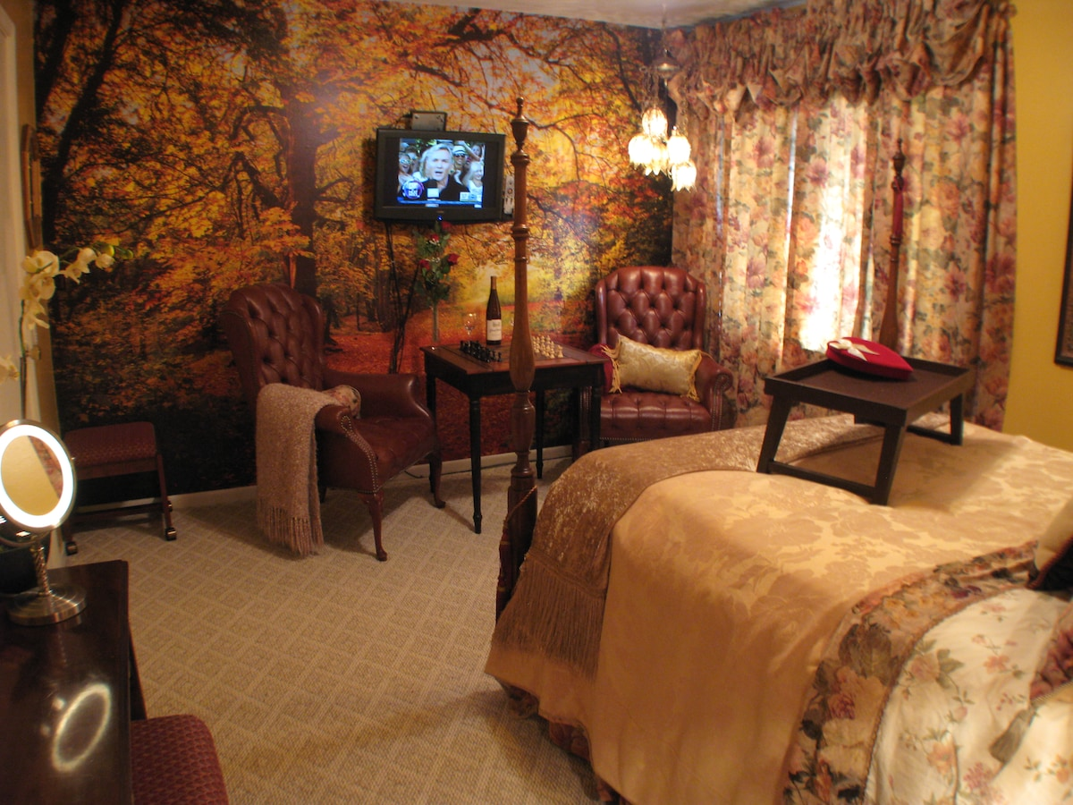 The Woodland Rose Room features two leather wing chairs & a game tabel, TV w/Dish Network TV