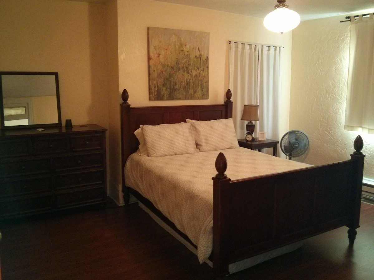 Beneath the Queen bed is a twin mattress that can be slid out at night for a 2nd bed.