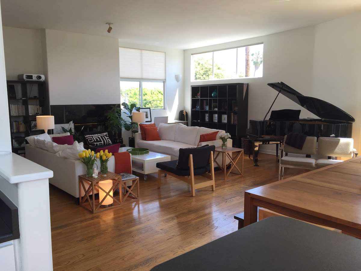 Living room with projector and piano