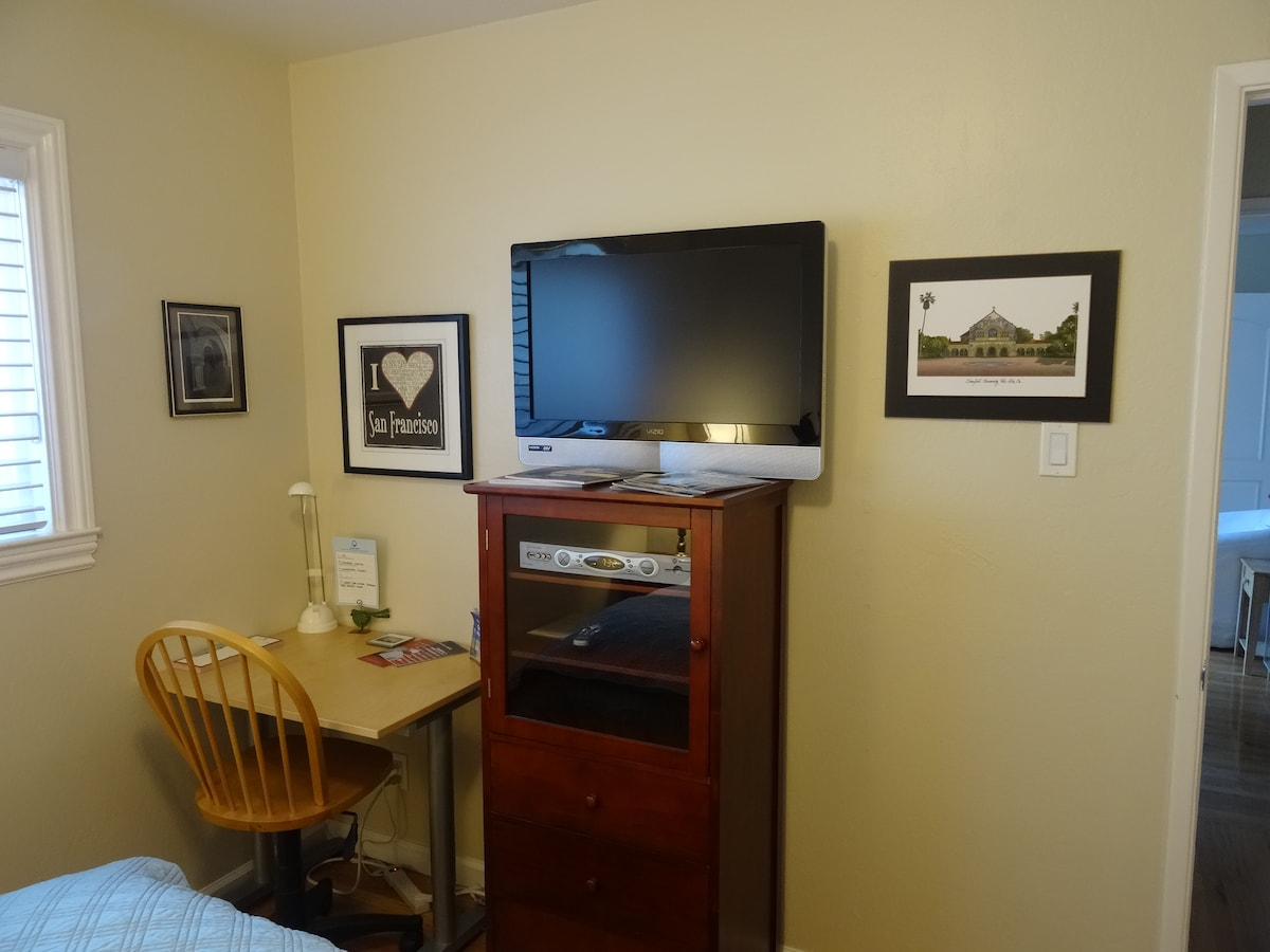 A small work desk and chair are provided for guests to use during their stay.