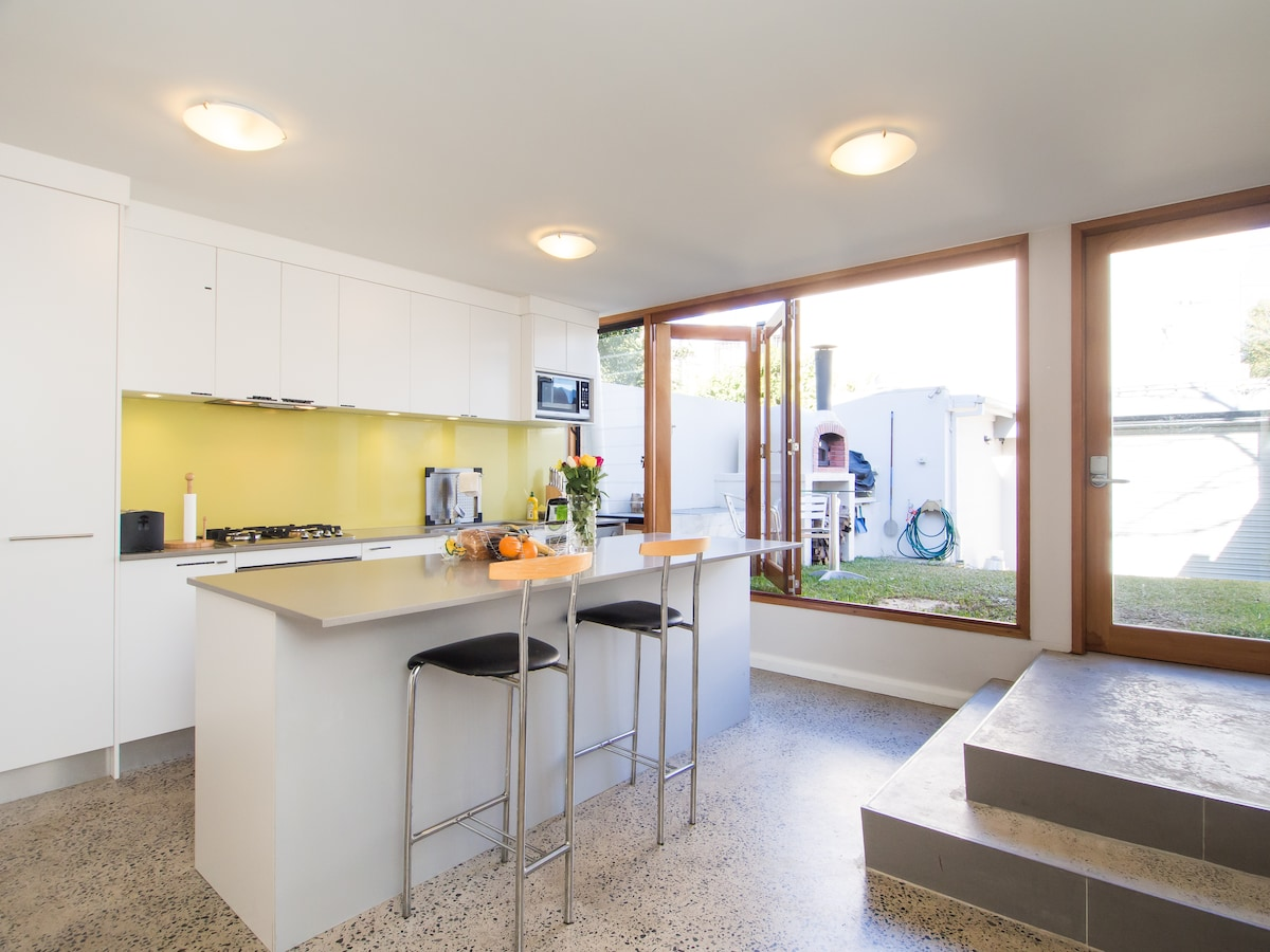 Bifold Doors Link the Kitchen with the Backyard and Woodfired Oven