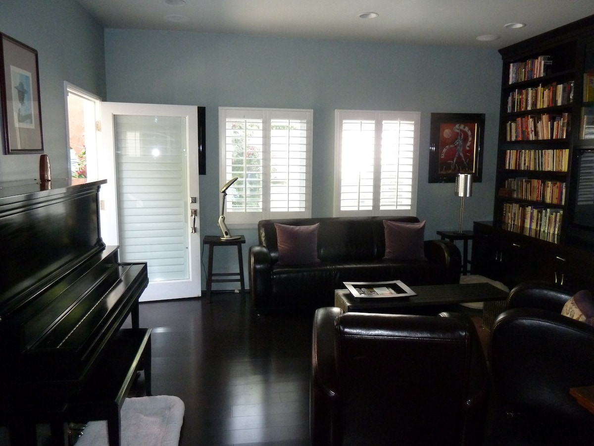 Library/TV/Music sitting room with Brinkerhoff upright piano