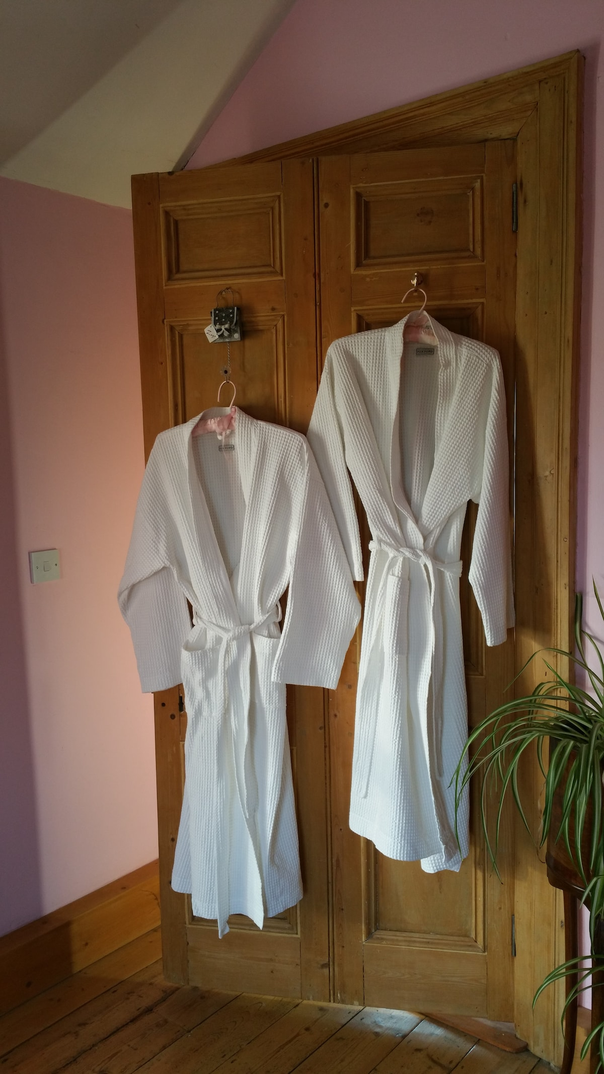 Linen dressing gowns for guests use.