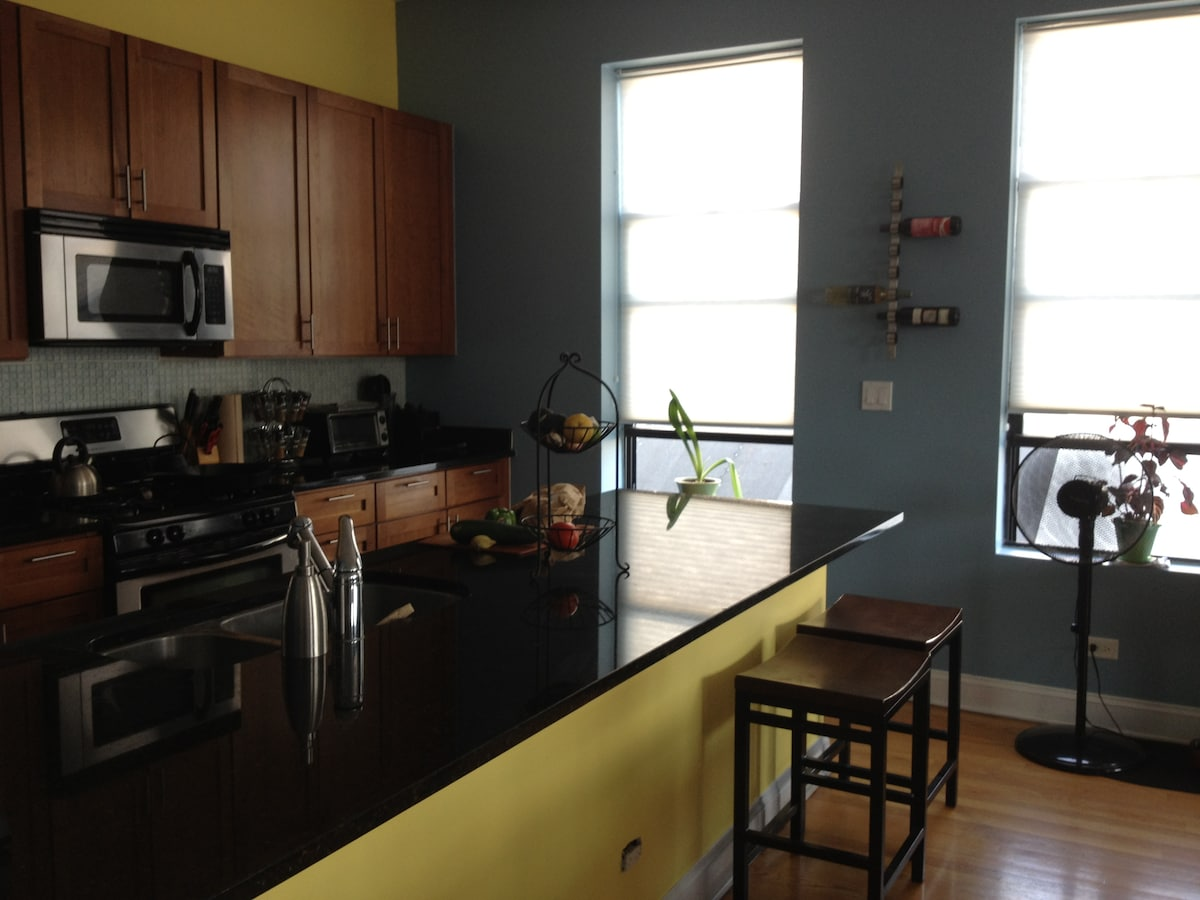Bright open kitchen with great view of downtown