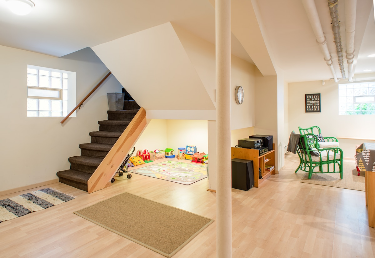 A half flight of stairs gets you in and out of the apartment. Play area under stairs.