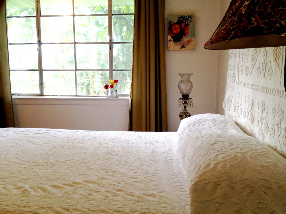 Clean bright comfortable rooms looking out into the garden