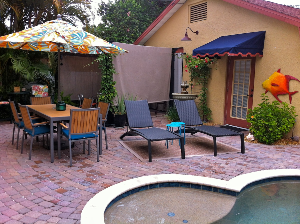 Enclosed, private patio with plenty of dining and sitting areas in sun or shade