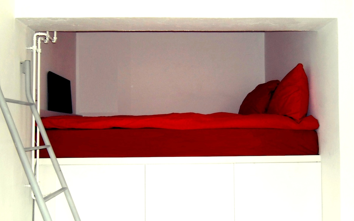 Built-in bed for 1-2 people with wardrobes underneath (h: 155 cm, w: 200 cm, d: 120 cm).