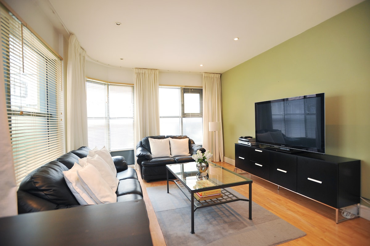 Living room with 55 inch plasma TV, with Sky Plus, Apple TV & integrated internet.