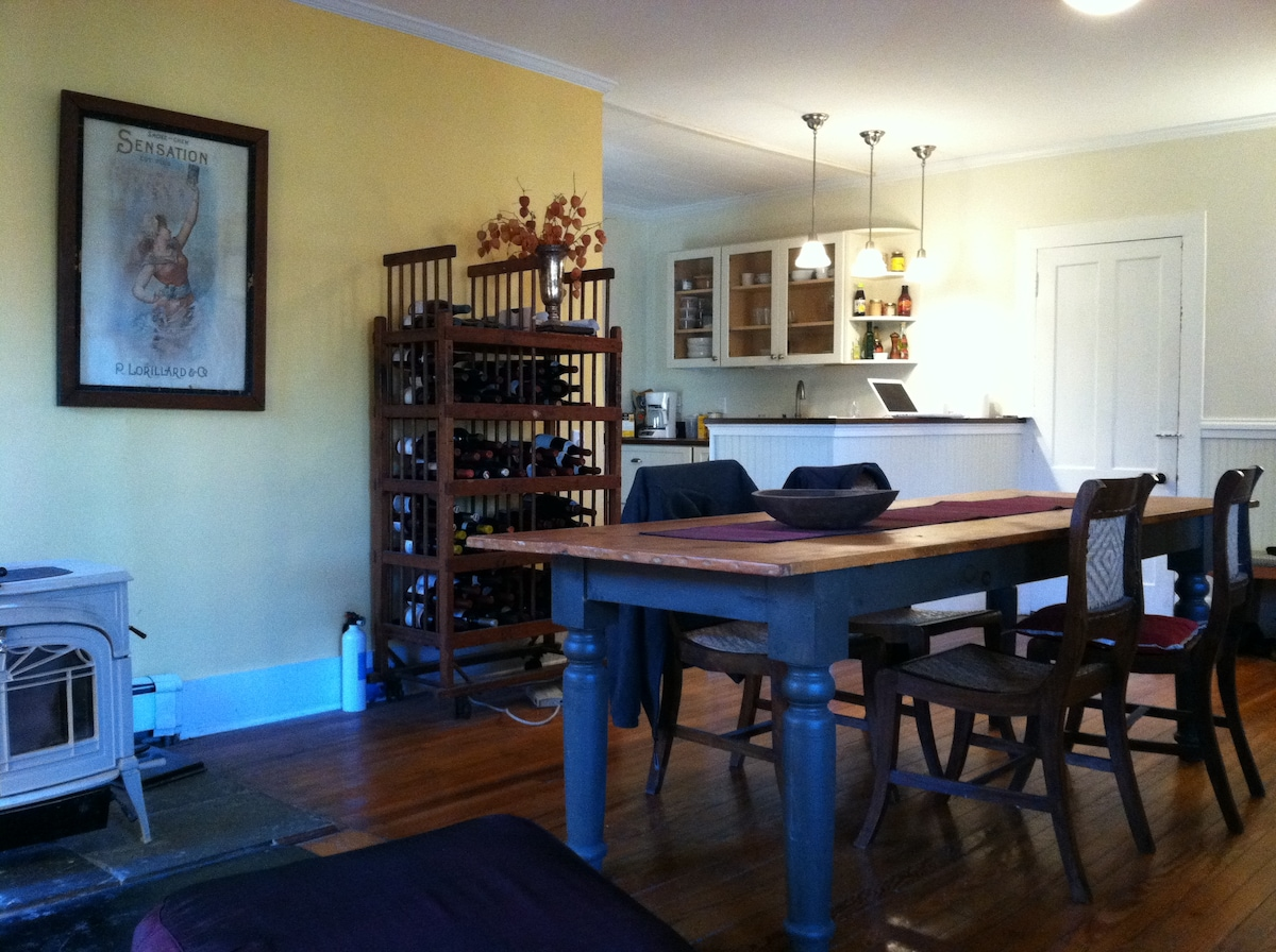 farm table, wood stove and kitchen