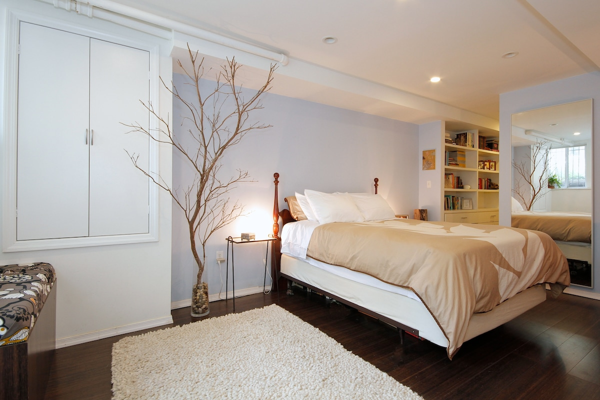 Bright and spacious bedroom with window seat.