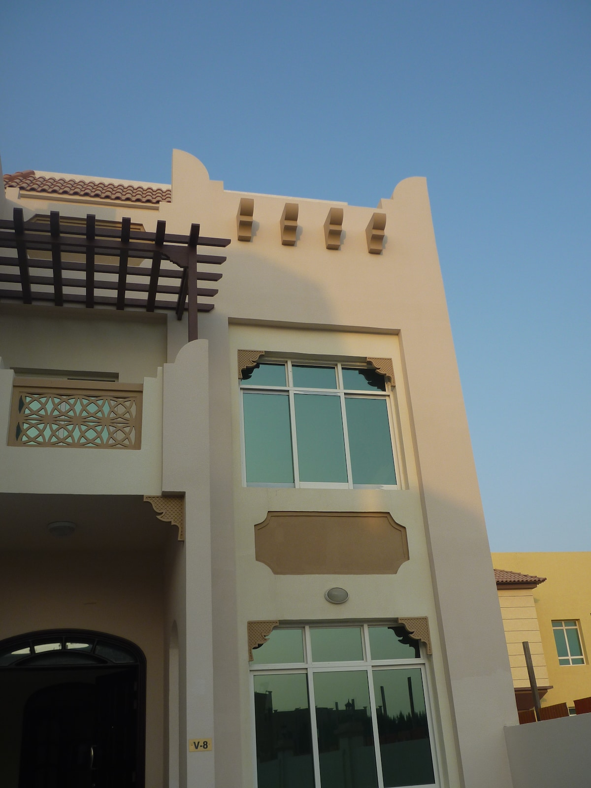 Front view of three stories villa