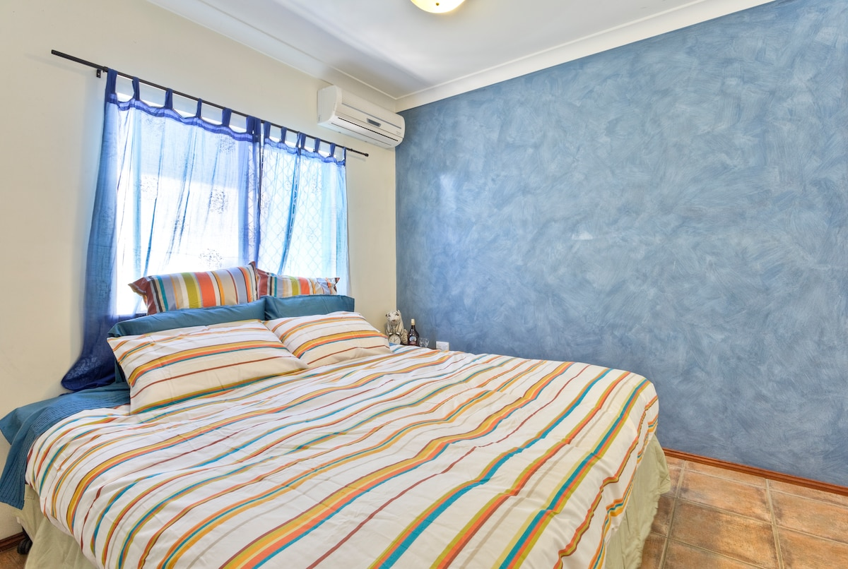 Big comfy king size bed, in our cool blue themed room. Air-conditioned for warm tropical nights.