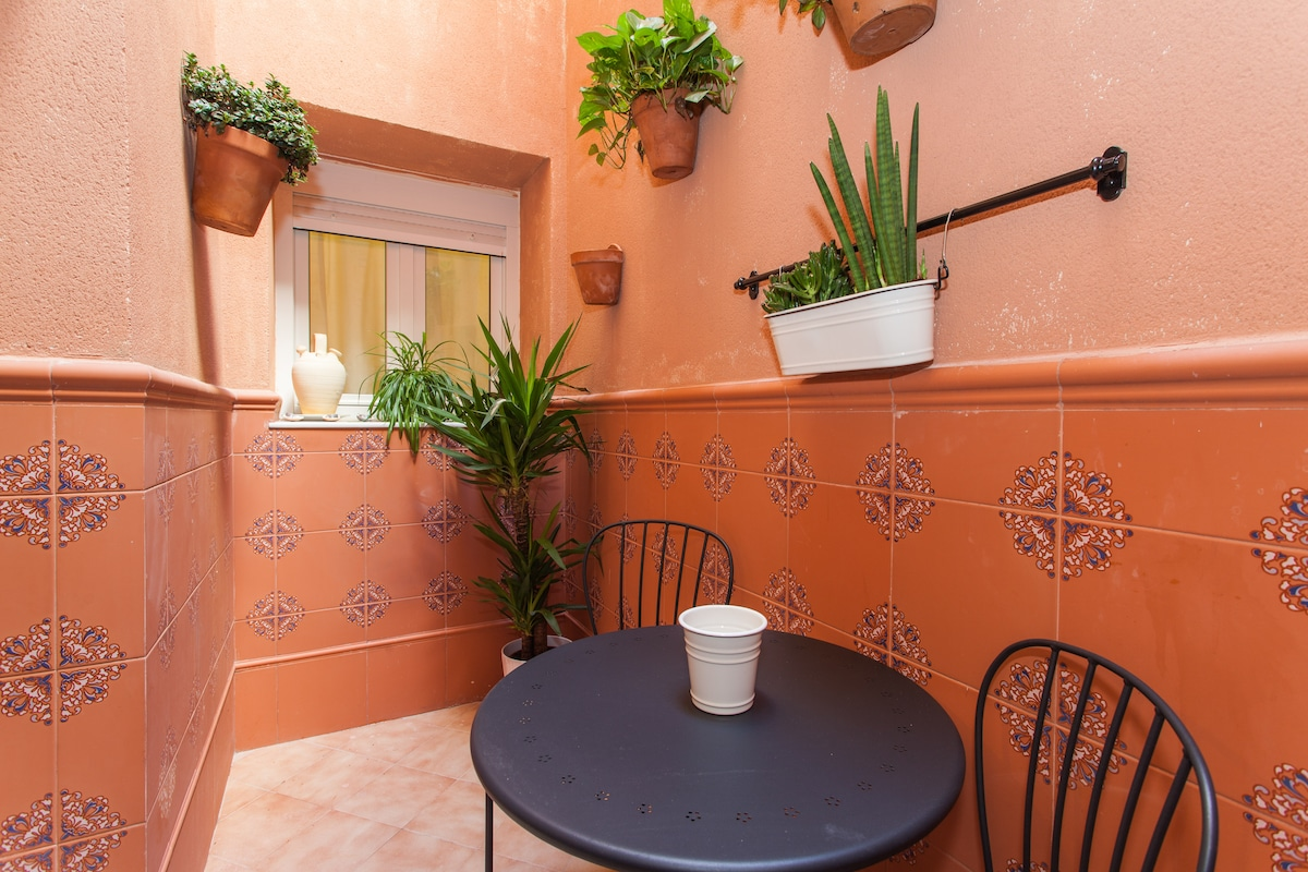 Tiny Andalusian-style private patio.