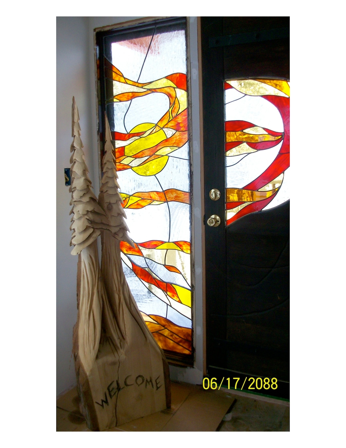 Main Entry with original stain glass door and side light.