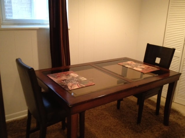 A beautiful dining room table to enjoy all of the comforts of home.