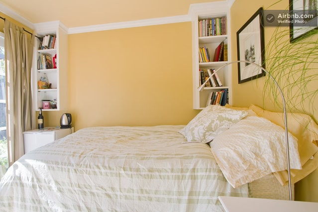 Cozy Bed, books for browsing, tea kettle for your morning beverage.
