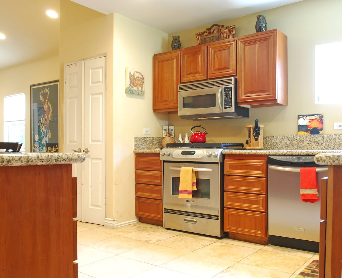 Big kitchen with oven, dish washer, refrigerator, microwave and washer and dryer