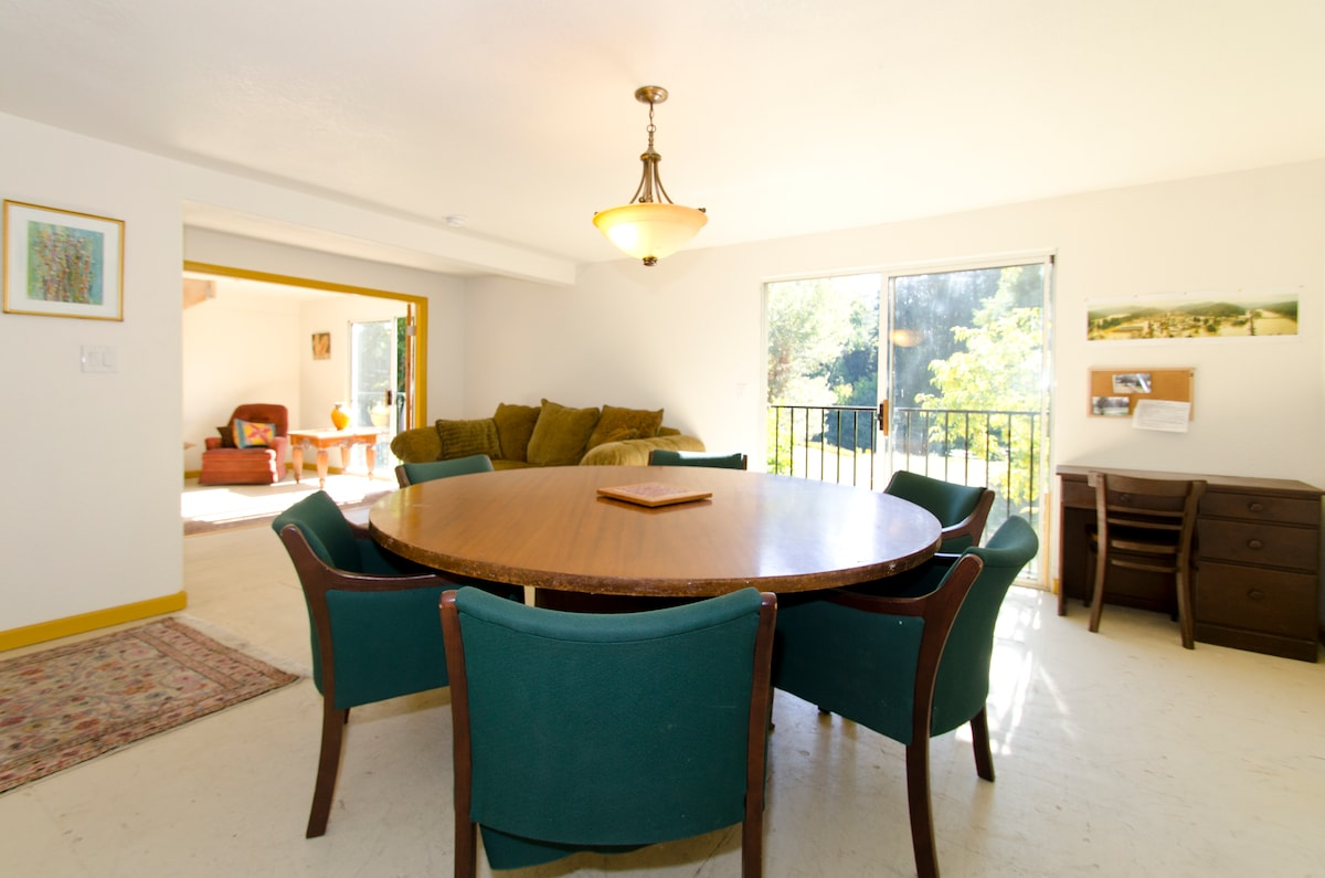 Another shot of the dining room taken from TV console and looking toward French door entrance to flat.