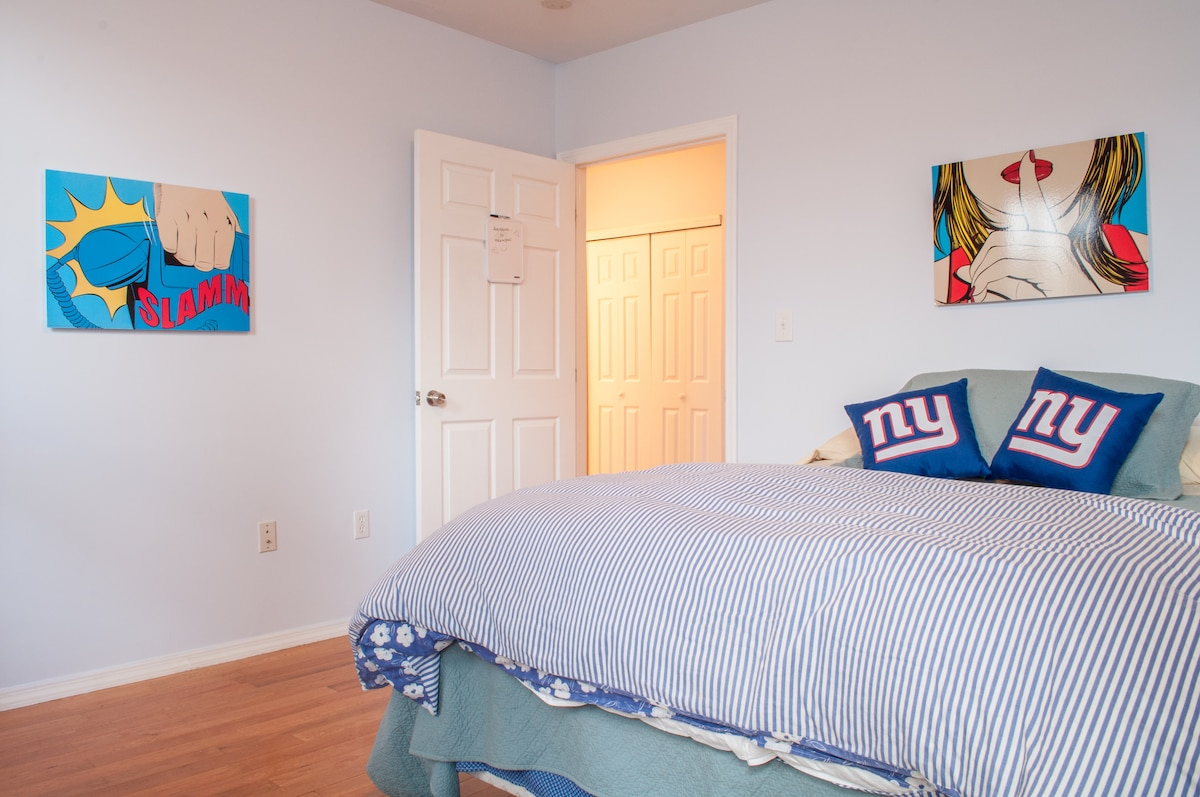 Big, bright room with queen bed, lots of closet space and a locking door.
