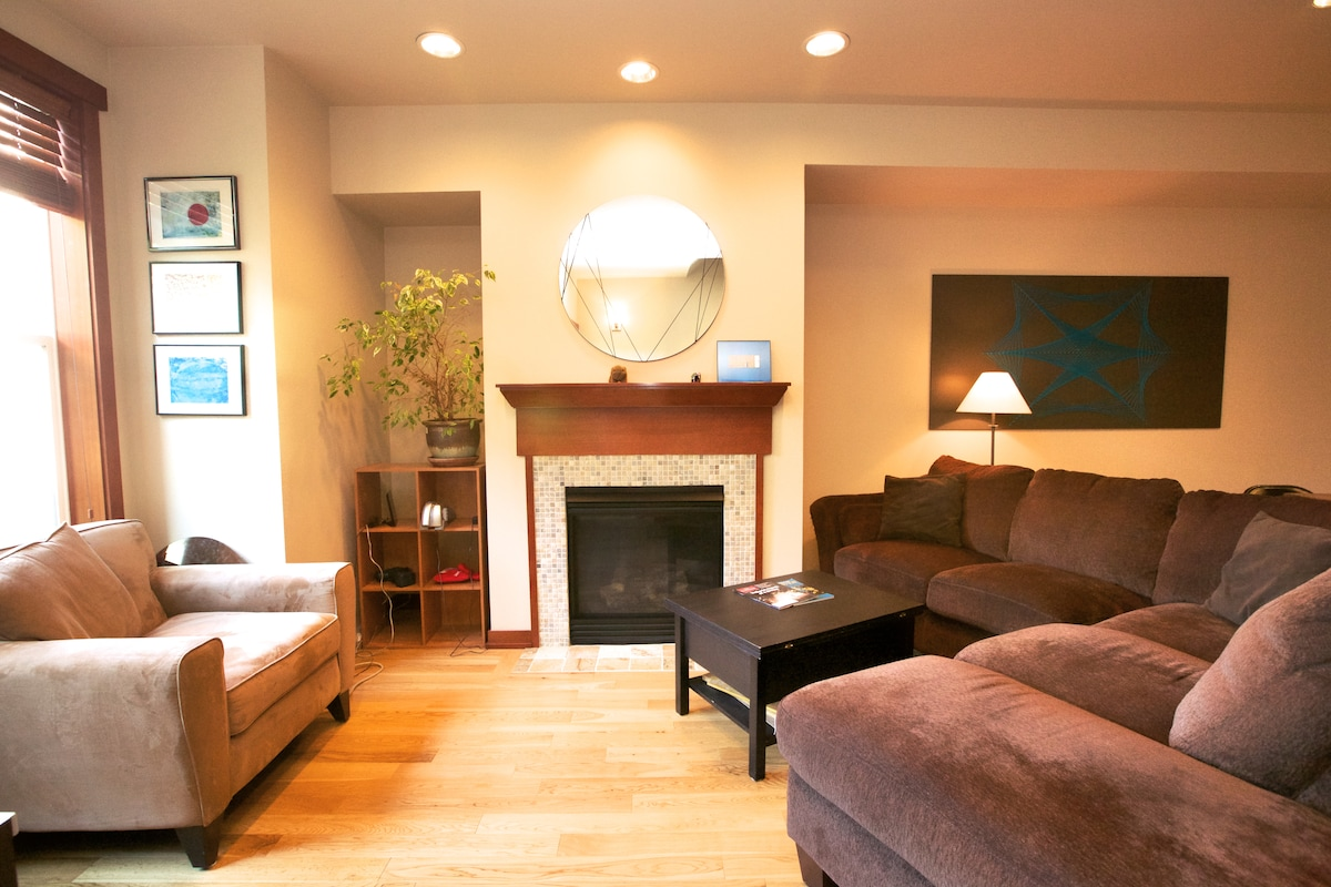 Our living room space with gas fireplace is on the second floor with a little view of the Space Needle.