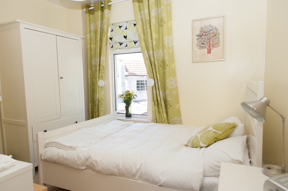 bright and cheerful double bedroom - with thick down duvet and comfy mattress