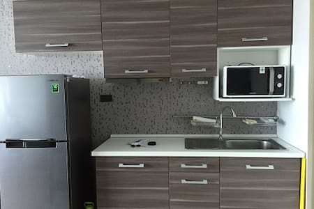 This is a newly renovated studio with modern decor. It has a private bathroom. It has a little kitchen and dining area for guests as well as a space for the living room. It also has a balcony with great view! Only less than 1 min to MRT and the park!