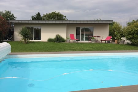 Small house with shared swiming pool - House
