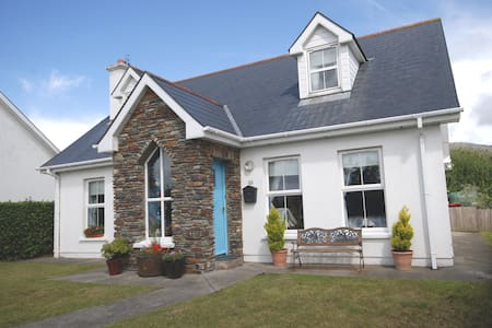 Very comfortable year round house on the outskirts of the pretty village of Schull. On the Wild Atlantic Way. Ideal base for touring Mizen and Sheeps Head. 3 double bedrooms, two en suite and family bathroom. Wood burning stove, cosy sunroom, garden.