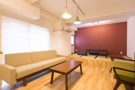 *This room is divided into several rooms.   But  you can stay in individual room.  *Only Sofabed and Table in your room, very simple. *Shared Shower, Toilet, and air conditioning. There are another 10 rooms any place other than this room.