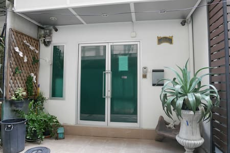 By The Station Guesthouse Located in downtown Bangkok, 2 min from the National Stadium BTS Sky Train Station  Equipped with Free Wifi, Private Bathroom, Refrigerator, Microwave, and Cable TV.