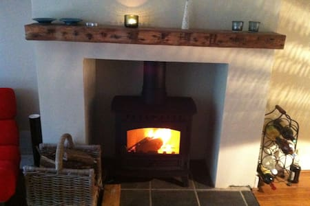 Winter log fires and summer BBQ's - House
