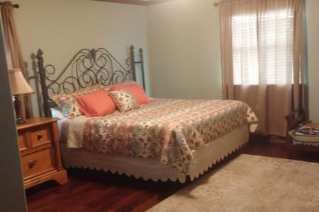 King Size bed in large room. - Sealy - House