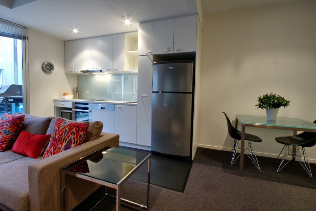 The kitchen has quality appliances including a dishwasher and is fully equipped for cooking