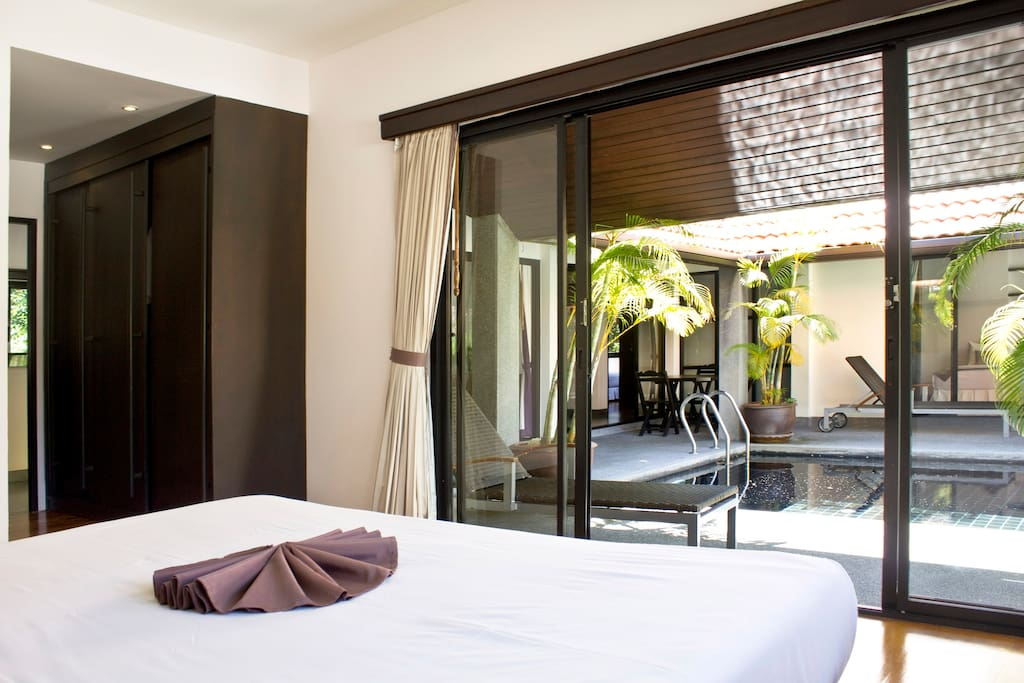 View from master bedroom to the pool / Вид из главной спальни на бассейн