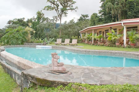 We offer 2 rooms in the main house, each with a separate entrance, private bath, queen size bed, a small refrigerator and coffeemaker.  These rooms open to a large veranda with a beautiful view of Lake Arenal, Arenal volcano and our swimming pool.