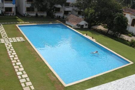 Upbeat 5 star luxury apartment with Swimming Pool, Kitchen, Gym at Candolim beach Goa.