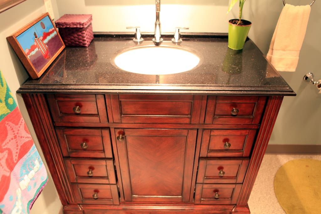 Sink vanity with plenty of storage in private bath