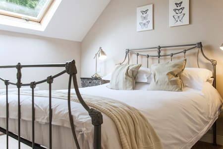 Hit the hay in our recently restored courtyard hayloft.  One ensuite double bedroom and adjoining sitting room (TV, Books & Games) with kitchen area. The comfy sofa bed can accommodate two extra guests.  The perfect spot for a short break.