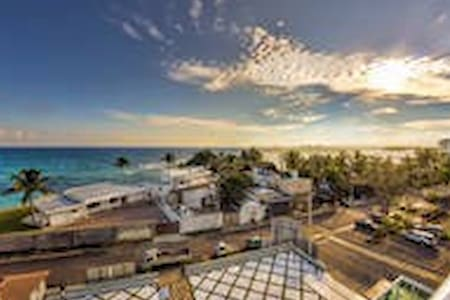 2 /2 bedroom ocean front building, in a safe and fun environment, across from amazing private beach.   5 minutes to supermarkets, as well as 15 minutes to the Las Americas International Airport and 30 minutes to Santo Domingo City.