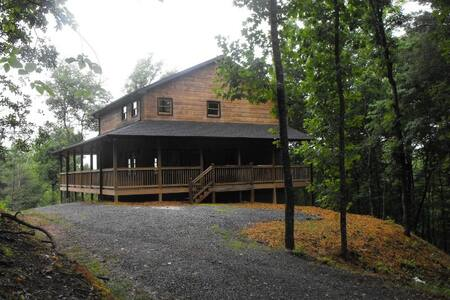 This is a 3 bedroom mountain view cabin with an additional loft sofa bed, for a total of four beds.  Quiet area with nearby access to Toccoa River and Lake Blue Ridge.  Fire Pit, Hot Tub, Screened Porch, Jetted Tub. Price includes 12% lodging tax.