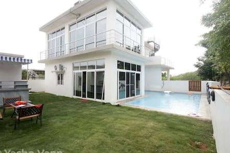 Yasho Van is a 2.5 bedroom villa with a 25 feet pool located in the serene surroundings of a national forest in Forest Ridge, Shamirpet, Hyderabad.  If you want to know what absolute silence is like...  If you want to wake up to the sounds of the forest... If you want to walk barefoot on wet grass with a hot cup of chai... If you want to relax with a chilled beer listening to the water... If you are looking for a rejuvenating weekend in a home away from home then Yasho Van is the place.