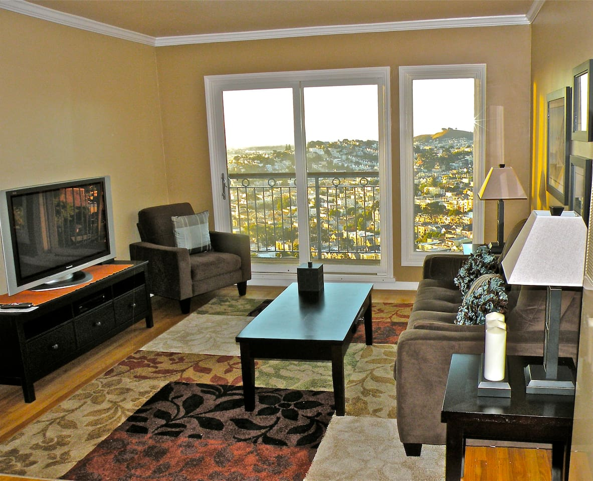 Living room and balcony - with panoramic view of the City and the bay!!