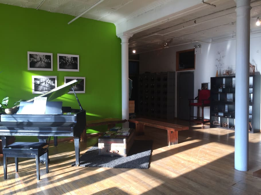 Loft - Super spacious common area with baby grand piano, art + full of light!
