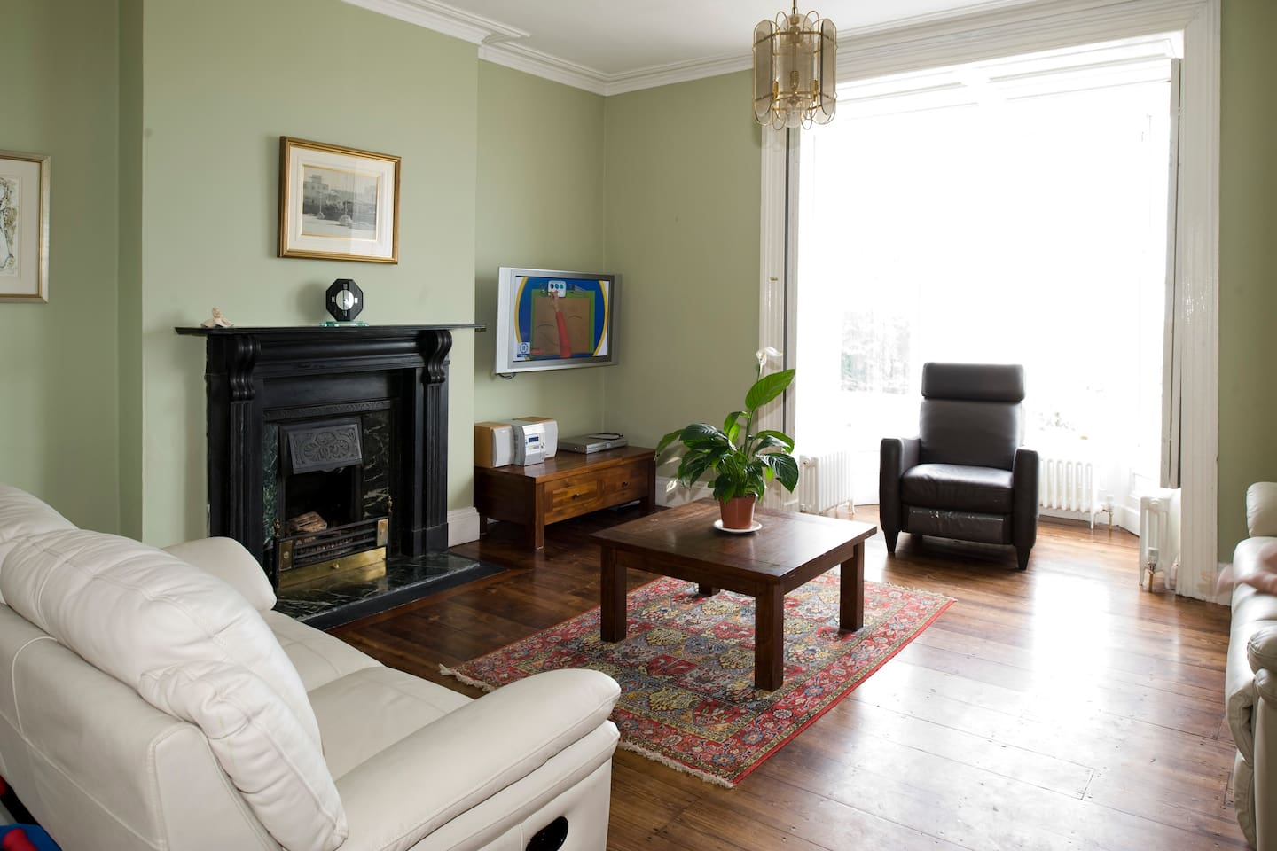 Living Room with recliner sofas and widescreen satellite TV