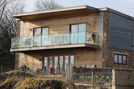 Boasting amazing views of the Yorkshire Dales, the Lakeland Fells and the spectacular sunsets over Morecambe Bay, Jackdaw Quarry Heights is one of a handful of stunning eco lodges set on the cliff above the clear, blue water of Jackdaw Quarry