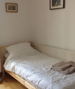 Clean airy single room free parking