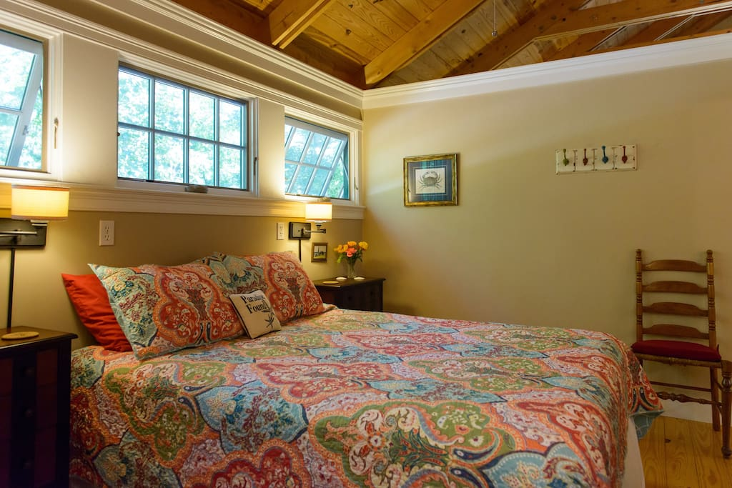 Bedroom with queen bed and ceiling fan