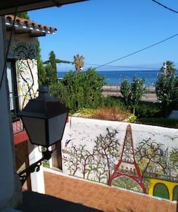 Casa rústica frente al mar