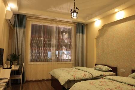 Home-feel Hotel - Zhangjiajie Shi - Guesthouse